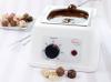 Màquina per fondre i temperar xocolata