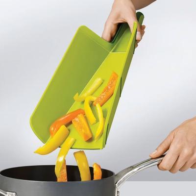 Taula de tallar i recollir Chop