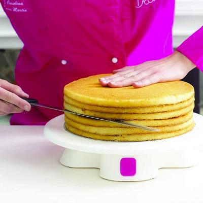 Base giratòria amb botó de parada decoració pastís