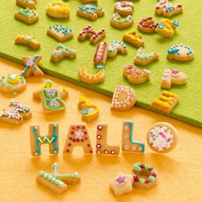 Juego 28 cortadores galletas letras colores